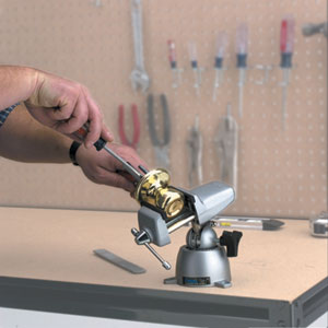The PanaVise 301 Standard Vise delicately holding a bronze door knob during off-door repairs