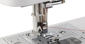 Automatic needle threading