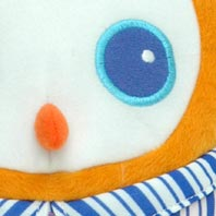 Embroidered details highlight owl's quality construction. His plush exterior is machine washable.