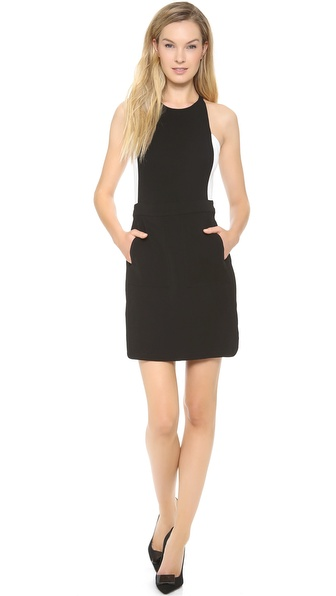 Shop A.L.C. online and buy A.L.C. Ruby Dress Black/White - A refined A.L.C. dress with chic, forward updates. A contrast hue accents the side insets, and topstitched pockets detail the draped skirt panel. Hidden back zip. Unlined. Fabric: Stretch crepe. 97% viscose/3% spandex. Dry clean. Made in the USA of fabric from Turkey. MEASUREMENTS Length: 33in / 84cm, from shoulder. Available sizes: 4