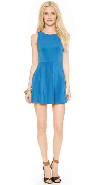 Shop alice + olivia online and buy Alice + Olivia Monah Sleeveless Dress - Marine - A flounced skirt adds a playful feel to a fit and flare alice + olivia dress, cut from ribbed, mid weight jersey. Exposed back zip. Lined bodice. Fabric: Ribbed mid weight jersey. Shell: 60% rayon/20% cotton/17% nylon/3% spandex. Lining: 90% nylon/10% spandex. Dry clean. Imported, China. Measurements Length: 31in / 79cm, from shoulder Measurements from size 4. Available sizes: 2,4,6,8,10,12