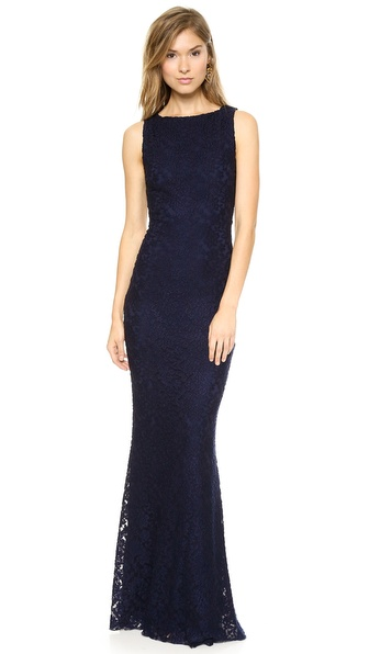 Shop alice + olivia online and buy Alice + Olivia Sachi Gown Navy - Floral embroidery adds rich texture to a mesh alice + olivia gown. The curve hugging silhouette flares at the hem, and an open back adds seductive drama. Button closure and exposed back zip. Lined. Fabric: Lace. Shell: 50% nylon/35% acrylic/15% wool. Lining: 97% polyester/3% spandex. Dry clean. Imported, China. Measurements Length: 63in / 160cm, from shoulder Measurements from size 4. Available sizes: 0,2,4,6,8,10,12