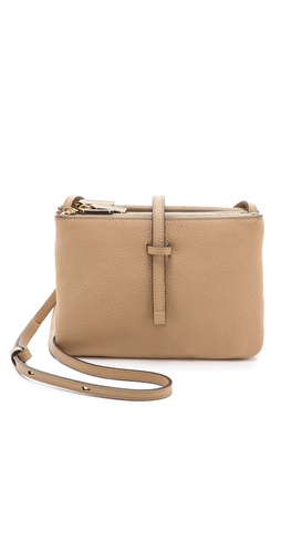 Kupi Annabel Ingall tasnu online i raspordaja za kupiti A wrinkled leather Annabel Ingall cross-body bag has a minimalist design with gold-tone hardware. A top strap fastens 2 detachable pouches from the center main pocket. Suede-lined. Adjustable shoulder strap.  Leather: Cowhide. Weight: 19oz / 0.54kg. Imported, China.  MEASUREMENTS Height: 6.5in / 16.5cm Length: 9in / 23cm Depth: 2in / 5cm Strap drop: 21in / 53.5cm - Honey