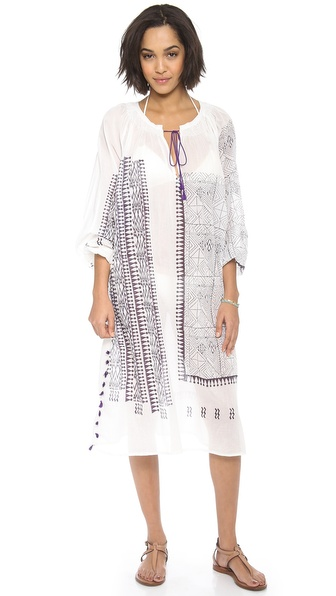 Shop Antik Batik online and buy Antik Batik Carla Dress White - A bohemian Antik Batik dress, styled in a geometric inspired print. Ruching details the split neckline, and playful tassels accent the silhouette. Long sleeves. Semi sheer. Fabric: Plain weave. 100% cotton. Hand wash. Imported, India. MEASUREMENTS Length: 45in / 114cm, from shoulder. Available sizes: 36