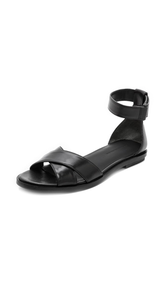 Kupi Alexander Wang cipele online i raspordaja za kupiti These minimalist leather Alexander Wang sandals are designed with crisscross vamp straps for a feminine twist. Velcro ankle strap and structured heel cap. Rubber heel patch at leather sole. Leather: Cowhide. Imported, China. Available sizes: 35,35.5,36,36.5,37,37.5,38,38.5,39,39.5,40,41