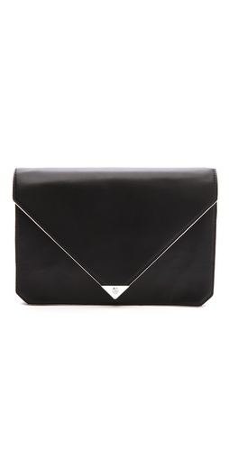 Kupi Alexander Wang tasnu online i raspordaja za kupiti This modern Alexander Wang clutch is crafted in smooth leather and finished with pale edges, lending a hit of definition to the angular shape. A polished silver-tone corner tips the front flap, which fastens with a snap closure. Pleated side gussets offer easy access to the divided, lined interior, which houses 3 compartments, 2 slim pockets, and a zip pouch pocket. Dust bag included.  Leather: Calfskin. Weight: 22oz / 0.6kg. Imported, China.  MEASUREMENTS Height: 7in / 18cm Length: 10.5in / 26.5cm Depth: 2in / 5cm - Black