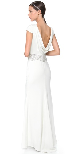 Shop Badgley Mischka Collection online and buy Badgley Mischka Collection Cowl Back Beaded Gown - Intricate beading encircles the waist of this Badgley Mischka Collection gown, while the draped cowl back reveals an elegant glimpse of skin. Hidden side zip. Cap sleeves. Fully lined.  Fabric: Stretch crepe. Shell: 98% polyester/2% spandex. Lining: 97% polyester/3% spandex. Dry clean. Imported, China.  MEASUREMENTS Length: 62in / 157.5cm, from shoulder - Ivory