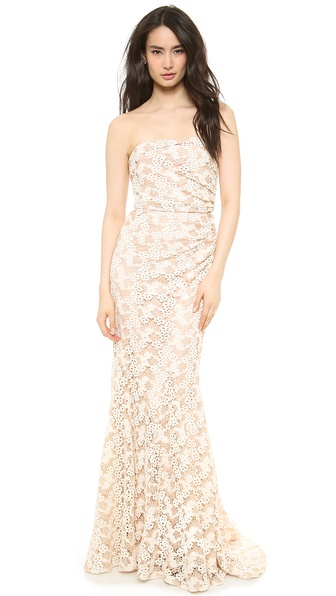 Kupi Badgley Mischka Collection haljinu online i raspordaja za kupiti Intricate, two tone floral lace brings a charming element to this striking Badgley Mischka gown. The flattering mermaid silhouette is detailed with pleats along the draped, boned bodice, and the floor length skirt falls to a short train. Strapless. Hidden side zip. Fully lined. Fabric: Intricate lace. Shell: 100% cotton. Lining: 100% polyester. Dry clean. Imported, China. MEASUREMENTS Length: 62in / 160cm, from center back. Available sizes: 0,2,4,8