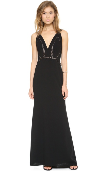 Shop BCBGMAXAZRIA online and buy Bcbgmaxazria Penelope Gown Black - A BCBGMAXAZRIA maxi dress with subtle allure. Angled seams join the sheer lace insets, revealing veiled peeks of skin. Buttons secure the elongated keyhole. Hidden back zip. Lined. Fabric: Slinky crepe. 100% polyester. Dry clean. Imported, China. Measurements Length: 58in / 147.5cm, from shoulder Measurements from size 4. Available sizes: 0,2,4,6,8,10,12