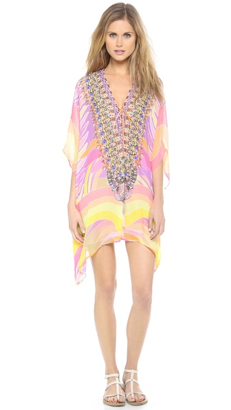 Shop Camilla online and buy Camilla Short Lace Up Caftan Kundalini - Bright Swarovski crystals detail the lace up V neckline of this Camilla caftan, styled in a vivid print. Beads and tassels accent the string ties. Lined. Sheer. Fabric: Silk crepe. 100% silk. Dry clean. Imported, India. MEASUREMENTS Length: 31in / 79cm, from shoulder. Available sizes: One Size