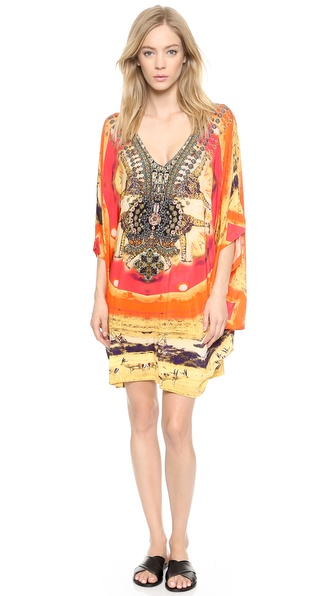Shop Camilla online and buy Camilla Bat Sleeve Cover Up Dress - The Trail Blazer - A wide, draped silhouette lends an alluring feel to a Camilla cover up dress, rendered in a vivid safari print. Multicolored stones detail the front placket, and oversized dolman sleeves complete the airy profile. V neckline. Fabric: Slinky jersey. 92% rayon/8% spandex. Dry clean. Imported, India. Measurements Length: 31in / 79cm, from shoulder. Available sizes: One Size