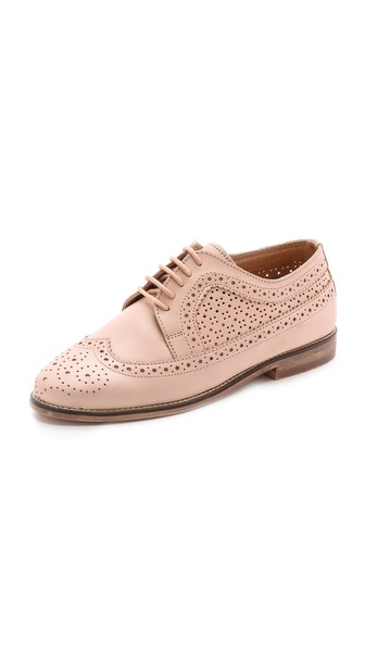 Kupi Carvela Kurt Geiger cipele online i raspordaja za kupiti Menswear inspired Carvela Kurt Geiger oxfords feel feminine in a delicate hue. Perforations and pinking maintain the classic feel, and tonal ties secure the lace up closure. Stacked heel and rubber sole. Leather: Cowhide. Imported, India. This item cannot be gift boxed. Measurements Heel: 0.75in / 20mm. Available sizes: 39