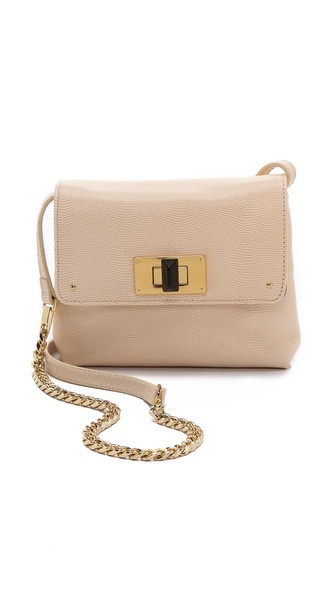 Kupi Club Monaco tasnu online i raspordaja za kupiti A lizard embossed leather Club Monaco cross body bag. The top flap secures with a turn lock clasp. The lined interior has 1 pocket. Cross body strap. Leather: Cowhide. Weight: 14oz / 0.41kg. Imported, China. MEASUREMENTS Height: 6in / 15cm Length: 7.5in / 19cm Depth: 2in / 5cm Strap drop: 22in / 56cm. Available sizes: One Size
