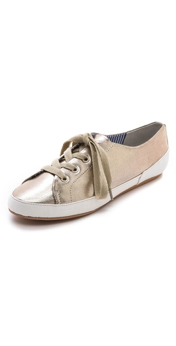 Shop Charles Philip online and buy Charles Philip Bianca Metallic Sneakers - Snake-embossed trim offers a tactile contrast to metallic faux leather on slim Charles Philip sneakers. Lace-up closure. Synthetic sole.  Imported, China. This item cannot be gift-boxed. - Gold