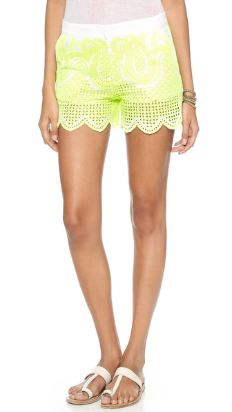 Shop Christophe Sauvat Collection online and buy Christophe Sauvat Collection Paisley Shorts Neon Yellow - Paisley eyelets wrapping these Christophe Sauvat Collection shorts create an airy feel and casual look. Scalloped cuffs. 4 pocket styling. Hook and eye closure and zip fly. Fabric: Plain weave. 100% cotton. Hand wash. Imported, India. MEASUREMENTS Rise: 10in / 25.5cm Inseam: 4in / 10cm. Available sizes: S