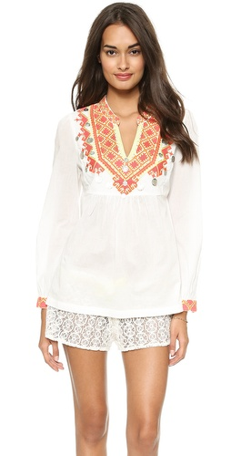 Shop Christophe Sauvat Collection online and buy Christophe Sauvat Collection Loreley Cover Up Top - Embroidery, beads, and medallions at the top and cuffs add an artsy feel to this airy Christophe Sauvat Collection tunic. Pintucking provides volume to the relaxed shape. Long sleeves. Semi-sheer.  Fabric: Plain weave. 100% cotton. Hand wash. Imported, India.  MEASUREMENTS Length: 26in / 66cm, from shoulder - White
