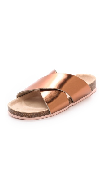 Kupi Charlotte Stone cipele online i raspordaja za kupiti Cross strap Charlotte Stone sandals, updated in metallic leather for glamorous shine. A molded cork footbed provides a comfortable fit. Rubber sole. Leather: Cowhide. Made in Italy. This item cannot be gift boxed. Available sizes: 35,36,37,38,39,40,41