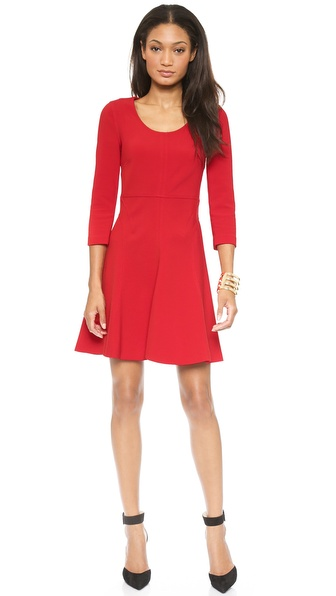 Kupi Diane von Furstenberg haljinu online i raspordaja za kupiti Raised, topstitched seams give this DVF dress an elegant, contoured look. The fit and flare silhouette has a scoop neckline and 3/4 sleeves. Hidden back zip. Unlined. Fabric: Soft stretch suiting. 63% polyester/27% viscose/7% cotton/3% spandex. Dry clean. Imported, China. Measurements Length: 34in / 86.5cm, from shoulder Measurements from size 2. Available sizes: 2,6,8,10