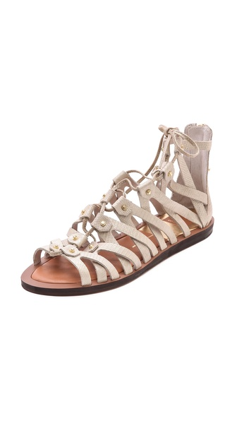 Kupi Dolce Vita cipele online i raspordaja za kupiti Intersecting lizard embossed leather straps create rich texture on lace up Dolce Vita gladiator sandals. Covered back zip. Rubber sole Leather: Calfskin. Imported, China. This item cannot be gift boxed. Available sizes: 7.5,8,8.5,9,10