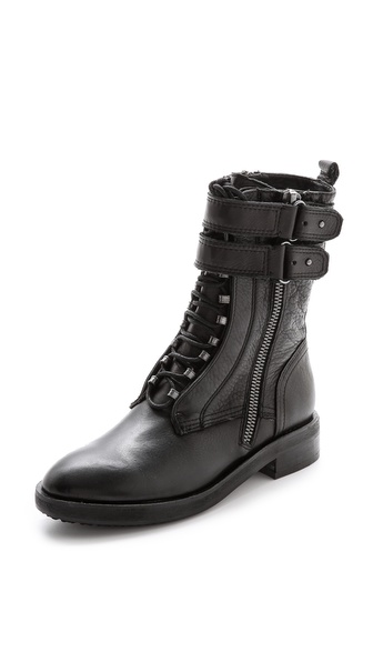 Kupi Dolce Vita cipele online i raspordaja za kupiti Dolce Vita brings punk edge to classic leather combat boots, styling these with button straps and exposed zip detailing. An inset lace up closure offers a snug fit, and a concealed zip closes the side. Stacked heel and lug sole. Leather: Cowhide. Imported, China. This item cannot be gift boxed. Measurements Heel: 1.5in / 35mm Platform: 0.5in / 12mm Shaft: 7.75in / 20cm. Available sizes: 6,6.5,7,7.5,8,8.5,9,9.5,10
