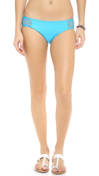 Shop Ella Moss online and buy Ella Moss Retro Bikini Bottoms Blue - Crocheted insets show peeks of skin on these Ella Moss bikini bottoms. Lined. 89% nylon/11% spandex. Hand wash. Made in the USA. Available sizes: XS