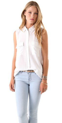 Shop Equipment online and buy Equipment Signature Sleeveless Blouse - This washed-silk blouse features a fold-over collar and a 9-button closure. Flap bust pockets and shirttail hem. Sleeveless. Semi-sheer.  * 29