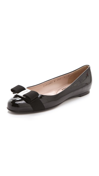 Kupi Salvatore Ferragamo cipele online i raspordaja za kupiti Luxe patent leather in a rich hue makes these Salvatore Ferragamo flats an irresistible classic staple. A tonal grosgrain bow loops through the polished logo medallion at the vamp, and the footbed is padded for extra comfort. Non slip rubber patch at leather sole. Leather: Calfskin. Made in Italy. Available sizes: 5.5,6,6.5,7,7.5,8,8.5,9,9.5,10