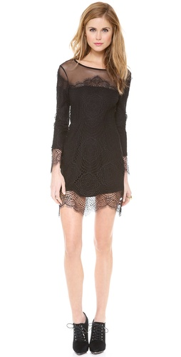 Shop For Love & Lemons online and buy For Love & Lemons Grace Mini Dress - Patterned crochet lends a romantic touch to a figure-hugging For Love & Lemons dress. Sheer, scalloped trim finishes the hem and cuffs, and a mesh yoke offers a peek of veiled skin. Long sleeves. Hidden side zip. Jersey lined.  Fabric: Crochet. Shell: 100% nylon. Lining: 62% polyester/33% rayon/5% spandex. Dry clean. Imported, China.  MEASUREMENTS Length: 34in / 86.5cm, from shoulder - Black