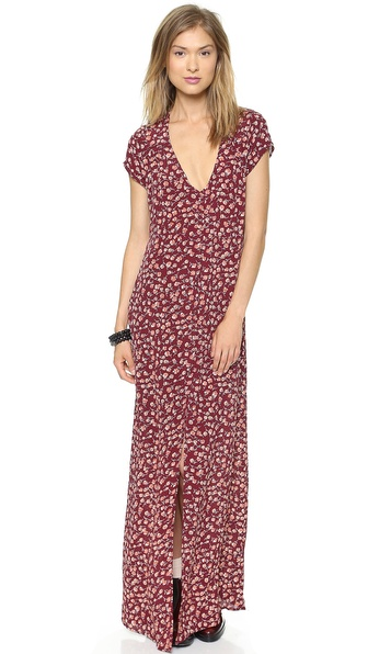 Shop Flynn Skye online and buy Flynn Skye Eterie Maxi Dress Rusty Dawn - Tiny florals lend graphic texture to a full length Flynn Skye dress. A back cutout and a front slit add a sexy finish. Covered button placket. Cap sleeves. Unlined. Fabric: Crepe. 100% rayon. Dry clean. Made in the USA. Measurements Length: 57.5in / 146cm, from shoulder Measurements from size 1. Available sizes: 3