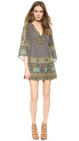 Shop Free People online and buy Free People Terra Nova Printed Dress Dark Combo - Bright geometric patterns lend a cheery touch to a casual gauze Free People dress. Soft ruching adds movement to the skirt, and a square cutout accents the back. Deep V neckline. 3/4 bell sleeves. Hidden side zip. Lined. Fabric: Crinkled gauze. Shell: 100% rayon. Lining: 65% cotton/35% rayon. Wash cold. Imported, India. Measurements Length: 30in / 76cm, from shoulder Measurements from size S. Available sizes: S