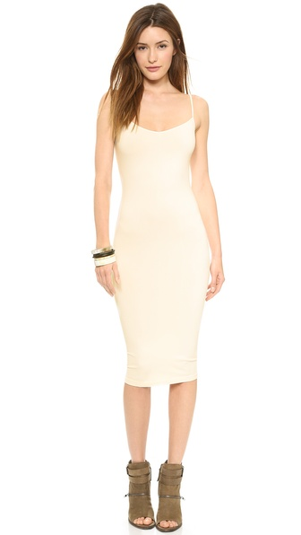 Shop Free People online and buy Free People Tea Length Slip Ivory - A discreet Free People slip in form fitting jersey. Adjustable shoulder straps. Tea length hem. Fabric: Jersey. 92% nylon/8% spandex. Wash cold. Made in the USA. Measurements Length: 41.25in / 105cm, from shoulder Measurements from size XS/S. Available sizes: XS/S