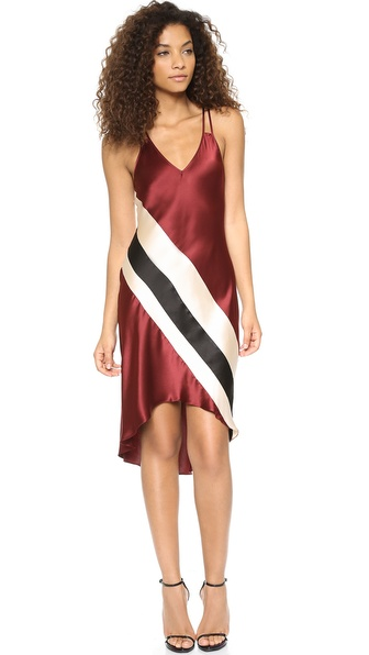 Shop Haute Hippie online and buy Haute Hippie Cami Stripe High Low Dress Merlot/Fallen Angel/Black - Bold stripes add a graphic element to a simple silk charmeuse Haute Hippie dress. Slender double shoulder straps crisscross the open back, and the uneven hem drapes lower in back. Unlined. Fabric: Silk charmeuse. 100% silk. Dry clean. Made in the USA. Measurements Length: 37.75in / 96cm, from shoulder Measurements from size S. Available sizes: L,M,S,XS