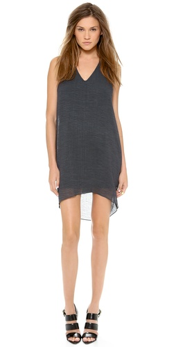 Kupi Helmut Lang haljinu online i raspordaja za kupiti A Helmut Lang dress in puckered gauze offers an airy silhouette with a touch of texture. The uneven hem dips in back. Lined.  Fabric: Puckered gauze. Shell: 65% triacetate/35% polyester. Lining: 94% polyester/6% spandex. Dry clean. Made in the USA.  MEASUREMENTS Length: 34in / 86cm, from shoulder - Cavern Blue