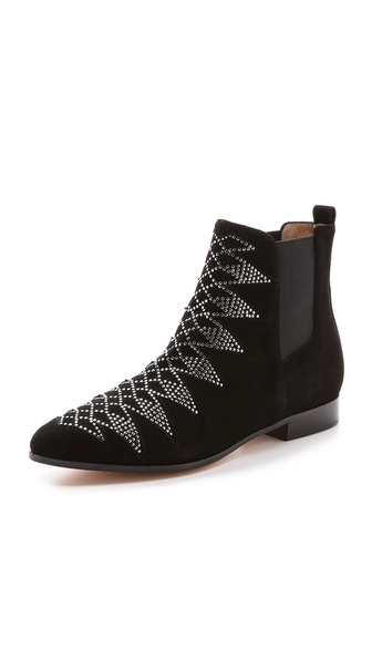 Shop IRO online and buy Iro Kim Studded Flat Booties - Black - Inset panels accented with flat, polished studs add a bohemian element to luxe nubuck IRO booties. The toe tapers to a structured point, and inset elastic gores offer effortless wear. Stacked heel and leather sole. Leather: Kidskin. Made in Italy. This item cannot be gift boxed. Measurements Heel: 0.75in / 20mm. Available sizes: 37,38,39