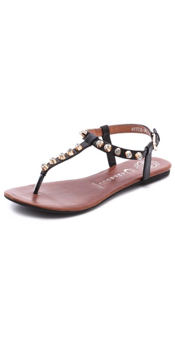Kupi Jeffrey Campbell cipele online i raspordaja za kupiti Simple leather sandals have edgy glamour with rhinestone inset studs accenting the straps. Buckle ankle strap. Rubber sole.  Leather: Kidskin. Imported, China. This item cannot be gift-boxed. - Black/Gold