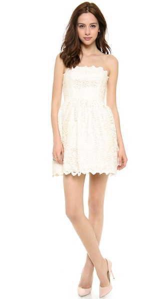 Shop Jill Jill Stuart online and buy Jill Jill Stuart Strapless Lace Dress Ivory - Scalloped edges draw a sweet outline on this strapless Jill Jill Stuart dress, cut from guipure lace for ornate elegance. Boning structures the bodice, and ruching lends volume to the skirt. Back zip. Lined. Fabric: Guipure lace. Shell: 100% polyester. Lining: 100% acetate. Dry clean. Imported, China. MEASUREMENTS Length: 25in / 63.5cm, from center back. Available sizes: 10,12