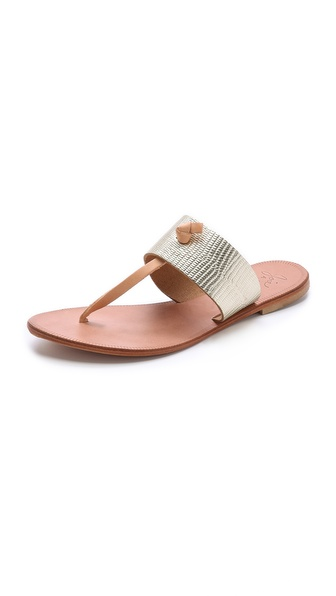Kupi Joie cipele online i raspordaja za kupiti Leather Joie sandals are perfect companions to a poolside look. Slip on, T strap design with a metallic, lizard embossed band. Leather sole. Leather: Cowhide. Made in Italy. This item cannot be gift boxed. Available sizes: 36,37,38,38.5,39,39.5,40,41