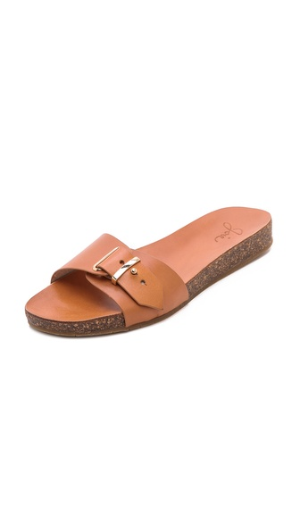 Shop Joie online and buy Joie Maddux Slide Sandals - Natural - Retro inspired Joie sandals pair a soft cork sole against a smooth leather upper. Polished hardware accents the adjustable strap. Rubber sole. Leather: Cowhide. Imported, China. This item cannot be gift boxed. MEASUREMENTS Heel: 1in / 25mm Platform: 0.5in / 12mm. Available sizes: 35