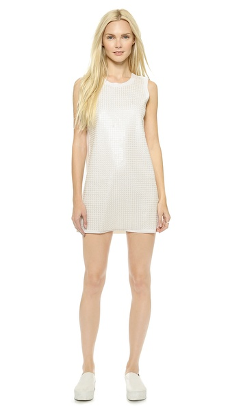 Shop JOA online and buy Joa Sequin Shift Dress White - A mesh panel detailed with sequins adds a shimmery layer to the front of this flirty JOA mini dress. Raw edges lend an undone touch. Sleeveless. Unlined. Fabric: Sequined mid weight jersey. Shell: 90% polyester/10% spandex. Trim: 100% polyester. Dry clean. Imported, China. Measurements Length: 31in / 79cm, from shoulder Measurements from size S. Available sizes: L,M,S,XS
