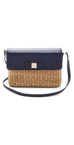Kupi Kate Spade New York tasnu online i raspordaja za kupiti Basket-woven straw creates a casual Kate Spade New York cross-body bag with leather trim. A bow accent lifts the magnetic flap, and the lined interior contains a zip pocket. Metal feet. Adjustable strap. Dust bag included.  Weight: 22oz / 0.62kg. Imported, Philippines.  MEASUREMENTS Height: 8in / 20cm Length: 10in / 25.5cm Depth: 3.5in / 9cm Strap drop: 21in / 53.5cm - Natural/French Navy