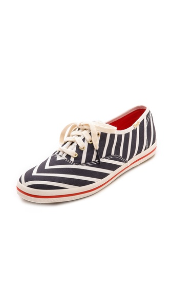 Kupi Kate Spade New York cipele online i raspordaja za kupiti These Keds for Kate Spade New York sneakers are patterned in bold stripes and trimmed with metallic aglets. Lace up closure and striped rubber sidewall. Crepe sole. Imported, China. This item cannot be gift boxed. Available sizes: 5.5,6.5,7.5,8,8.5,9,10