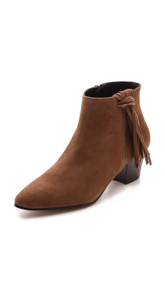 Shop KG Kurt Geiger online and buy Kg Kurt Geiger Shimmy Tassel Booties - Rust - A knotted tassel falls from the top line on rich suede KG Kurt Geiger booties. The simple silhouette is styled with a pointed toe and chunky, stacked heel. Exposed side zip. Rubber sole. Leather: Kidskin. Made in Spain. This item cannot be gift boxed. Measurements Heel: 2in / 50mm. Available sizes: 36,37,38,39,40,41