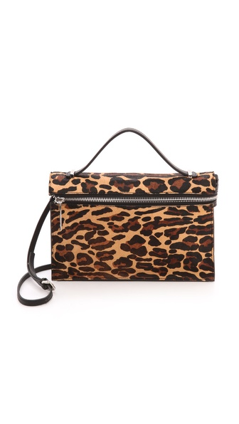 Kupi L.A.M.B. tasnu online i raspordaja za kupiti Leopard print haircalf gives a dose of attitude to this L.A.M.B. handbag. A front zip opens the top flap. The lined interior has 1 zip and 2 patch pockets. Polished metal hardware. Slide handle. Optional shoulder strap. Dust bag included. Fur: Dyed haircalf (cow), from China. Leather: Cowhide. Weight: 16oz / 0.45kg. Imported, China. Measurements Height: 7.75in / 20cm Length: 11.5in / 29cm Depth: 2in / 5cm Strap drop: 19.75in / 50cm Handle drop: 3.25in / 8cm THIS ITEM CANNOT BE SHIPPED OUTSIDE THE USA. Available sizes: One Size