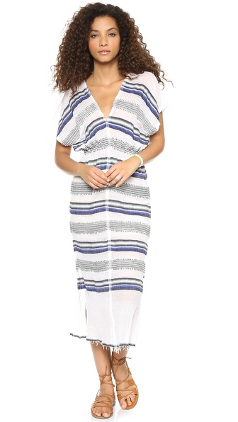 Shop Lemlem online and buy Lemlem Rucha Patio Dress - Navy - A rustic inspired Lemlem dress, patterned with bold stripes. The frayed hem adds a deconstructed touch, and side openings lend a flirtatious edge. Elastic defines the waist. V neckline and exposed back. Semi sheer. Fabric: Embroidered gauze. 85% cotton/15% acrylic. Dry clean. Imported, Ethiopia. Measurements Length: 50.75in / 129cm, from shoulder Measurements from size S. Available sizes: L,M,XS
