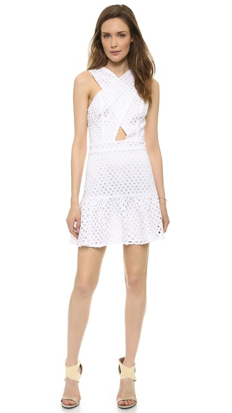 Shop Line & Dot online and buy Line & Dot Crossover Neck Eyelet Dress - White - Eyelet embroidery creates a grid like effect on this Line & Dot mini dress. Crossover panels frame the front cutout, and a flounced hem adds flirty shape. Exposed back zip. Lined. Fabric: Embroidered weave. Shell: 100% cotton. Lining: 100% polyester. Hand wash. Imported, China. Measurements Length: 30in / 76cm, from shoulder Measurements from size S. Available sizes: L