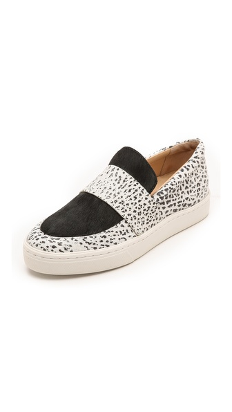 Shop Loeffler Randall online and buy Loeffler Randall Irini Haircalf Sneakers White/Black - Casual Loeffler Randall slip on sneakers cut from speckled leather and accented with sleek haircalf. A thick band lends a loafer inspired element, and padded piping trims the top line. The tonal sidewall covers a low platform. Rubber sole. Fur: Dyed haircalf (cow), from Brazil. Leather: Buffalo. Imported, Brazil. This item cannot be gift boxed. Measurements Platform: 1in / 25mm THIS ITEM CANNOT BE SHIPPED OUTSIDE THE USA. Available sizes: 6,6.5,7,7.5,8,8.5,9,9.5,10