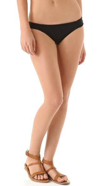Shop L*Space online and buy L*Space Sensual Solids Foxy Tab Bikini Bottoms Black - A touch of ruching softly gathers the sides of these solid bikini bottoms. Lined. 80% nylon/20% spandex. Hand wash. Made in the USA. Available sizes: L,XS