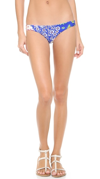 Shop Luli Fama online and buy Luli Fama Spanish Lullaby Bikini Bottoms Multi - Lace ruffles complement the girly aesthetic of these Luli Fama bikini bottoms, rendered in a colorful floral print. Lined. 80% nylon/20% spandex. Hand wash. Imported, Colombia. Available sizes: L,M