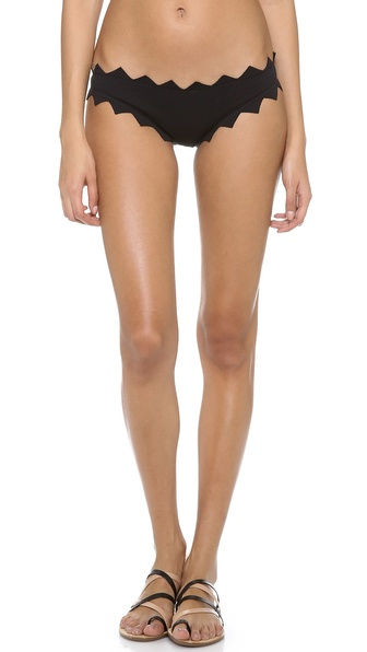 Shop Marysia Swim online and buy Marysia Swim Honolulu Bikini Bottoms Black - Zigzags form a jagged outline on these solid bikini bottoms. Allover basket weave texture. Lined. 88% nylon/12% lycra spandex. Hand wash. Imported, China. Available sizes: L,M,S,XS