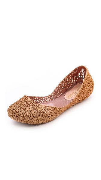 Kupi Melissa cipele online i raspordaja za kupiti Barely there flats formed from an intricate web of flexible, glitter infused PVC. The curved top line is left raw for a hand finished look. Removable insole. Rubber sole. Imported, Brazil. This item cannot be gift boxed. Available sizes: 7,9